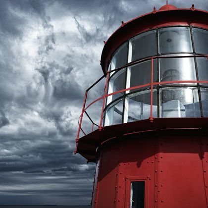 Lighthouse against a stormy sky