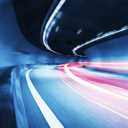 Blurred car lights going through a tunnel